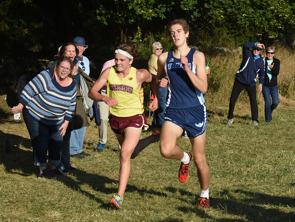 BRYAN EATON/Staff photo. Chris O'Donnell, left, and Triton's Aidan Gay-Killeen battle until the finish line.