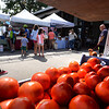 BRYAN EATON/Staff photo. Sunday's nice weather brought a good amount of people to Newburyport's Farmer's Market. Lots of produce are at their peak right now like these tomatoes from Heron Pond Farm in South Hampton, N.H.