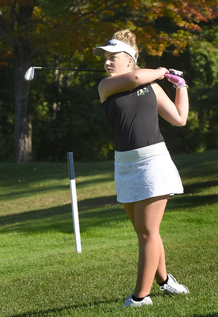 BRYAN EATON/Staff Photo. Ava Spencer hits the ball midway down the first fairway.