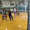 BRYAN EATON/Staff photo. The Pentucket High volleyball team meets with the coaches at the start of practice,
