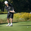 BRYAN EATON/Staff Photo. Pentucket's Alex Satkus putts on the first green.