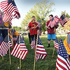 BRYAN EATON/Staff Photo. Salisbury Lions Club members and their junior chapter Leos, planted a couple hundred flags on the town common on Monday afternoon. The gesture is to remember the victims of the 9/11 terrorist attacks in 2001.