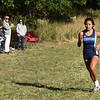 BRYAN EATON/Staff photo. Kylie Lorenzo crosses the finish.