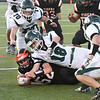 BRYAN EATON/Staff photo. Farlei Marques recovers a fumble on a kickoff return to Pentucket.