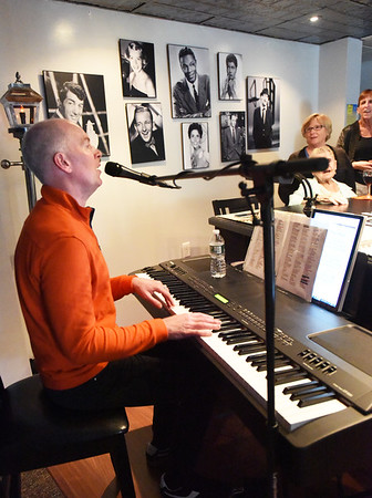 BRYAN EATON/Staff Photo. Pianist Jason Weber entertains residents of the Salisbury Assisted Living Center on Tuesday during at the Cabaret Piano Bar. The event is one of several the facility is hosting this week including a Seafood Festival to celebrate their 25th year.