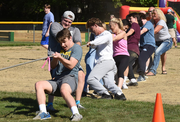 BRYAN EATON/Staff photo. Members of the Triton High School wrestling team, past and present, with other alum thrown in, battle in a tug-of-war with the Salisbury Fire and Police Departments in a field day activity for Salisbury Days.