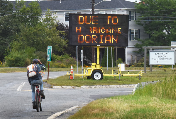 BRYAN EATON/Staff Photo. A sign at the entrance to the Salisbury Beach State Reservation reminds beachgoers that there are no lifeguards and there could be high surf and rip currents due to Hurricane Dorian.
