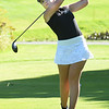BRYAN EATON/Staff Photo. Ava Spencer tees off on the second hole.