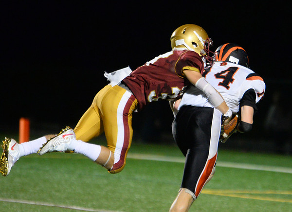CARL RUSSO/staff photo. Newburyport's Jason Tamayoshi dives at Ipswich's Justin Bruhm attempting to make the tackle. Newburyport high vs. Ipswich high in Friday night football action. 9/20/2019