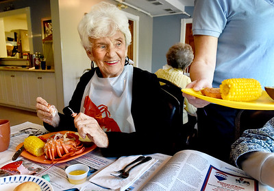 BRYAN EATON/Staff Photo. Betty Cloonan and fellow residents of the Assisted Lliving Center enjoyed a Lobsterfest followed by a wine tasting that pairs with seafood as part of their 25th Anniversary.