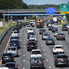BRYAN EATON/Staff Photo. Traffic was slow on Interstate 95 in Salisbury as people headed to Maine and New Hampshire for the holiday weekend in a view looking looking north from the Main Street overpass. Traffic was backed up further south from where photo was taken and could be heavy again early Saturday.