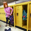 BRYAN EATON/Staff Photo. LIza Cattan stows her gear into her locker on the first day of school in Newburyport on Thursday. The seven year-old was starting second grade at the Bresnahan School.