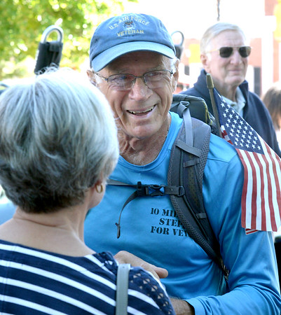 BRYAN EATON/Staff Photo. William Shuttleworth is greeted by people as he arrives at a ceremony welcoming him home for his cross country walk to bring attention to the plight of disabled and homeless veterans.