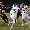 BRYAN EATON/Staff photo. Pentucket's Keegan O'Keefe, (16) gets the ball as Andrew Melone will fake the carry as Ipswich defender Jack Gillis, left, moves in.
