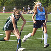 BRYAN EATON/Staff Photo. Meg Freiermuth moves down field as Triton's Mia Gustafson covers.