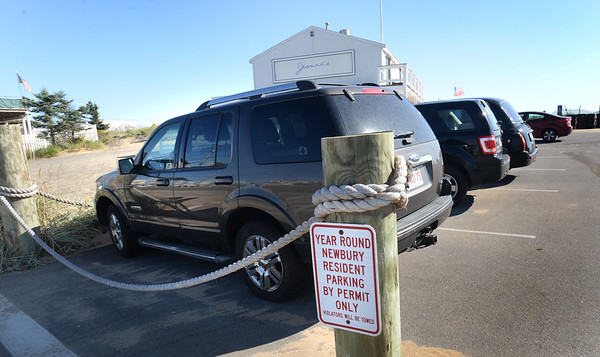 BRYAN EATON/Staff Photo. One of two signs at the entrance to the parking area at Plum Island Center warn that the lot is for residents only.