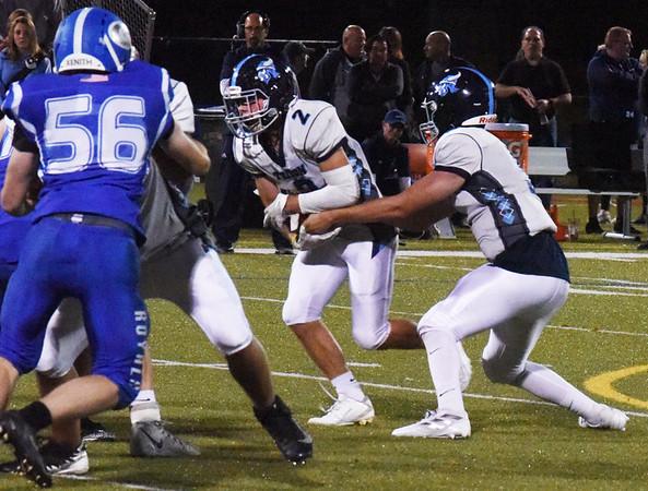 BRYAN EATON/Staff photo. Triton quarterback Kyle Odoy hands off to Ethan Tremblay.