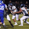 BRYAN EATON/Staff photo. Triton quarterback Kyle Odoy hands off to Ethan Tremblay.
