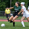 BRYAN EATON/Staff Photo. Sarah Riter and Newburyport's Molly Elmore battle for control.