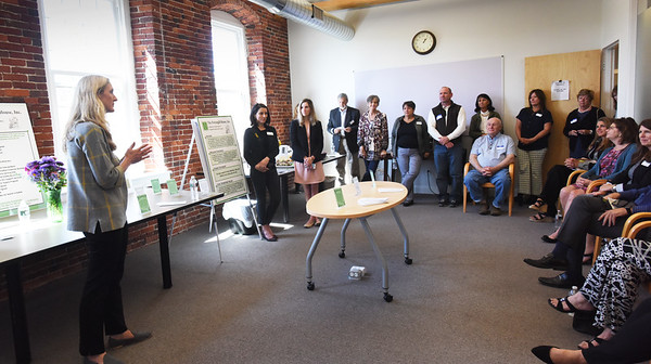 BRYAN EATON/Staff Photo. The Pettengill House, Inc. held a luncheon for donors of the expansion of their Amesbury facility on Thursday afternoon. Assistant Executive Director Tiffany Nigro thanked those in attendance before unveiling a plaque listing the donors that will hand in the lobby.