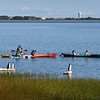 "BRYAN EATON/Staff Photo. Nock Middle School seventh-graders leave Joppa Park boat ramp and head to Plum Island Point on the calm Merrimack River. The are doing a ""place based education"" science unit on learning about the river and environs."