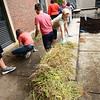 BRYAN EATON/Staff Photo. Weeds were pulled all around the Amesbury Middle School courtyard alond with picking up any trash, and sweeping the concrete areas.