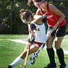 BRYAN EATON/Staff Photo. Newburyport's Maddie Medeiros gets pressure from Makenzie LeBlanc.