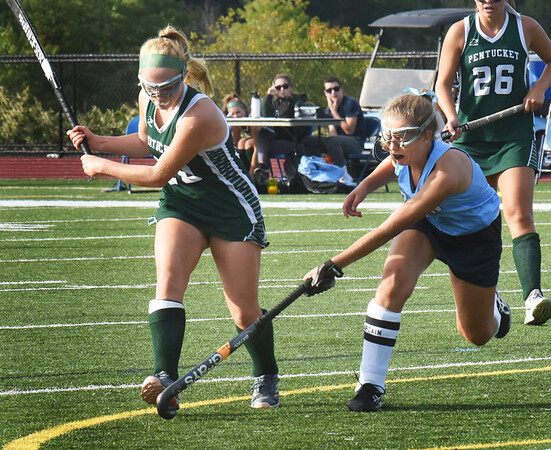 BRYAN EATON/Staff Photo. Jamie Bell tries to get the ball from Pentucket's Meghan Bean.