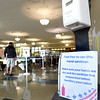 BRYAN EATON/Staff Photo. Hand sanitzing stations were availabe at Amesbury High School's cafeteria where voters cast their ballots.