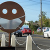 BRYAN EATON/Staff Photo. In the spirit of the times, the junior Dan Wilson of Wilson Welding on Bridge Road in Salisbury fashioned a sheet metal mask attached to a smiley face.
