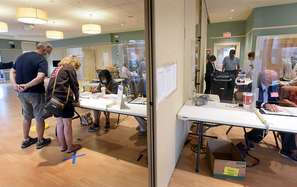 BRYAN EATON/Staff Photo. Signs informed voters to keep their distance as they waited for their ballots at Wards 5 and 6 at the Newburyport Senior and Community Center.