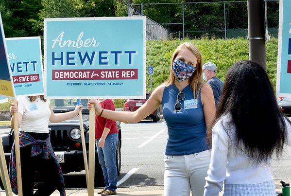 BRYAN EATON/Staff Photo. Amber Hewett running for the First Essex House District greets voters outside Amesbury High School.