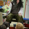 """BRYAN EATON/Staff photo. Amesbury Elementary School principal Walter Helliesen donned pirate garb for """"International Talk Like a Pirate Day."""" It was the fourth year he's read Pirate Pete's Talk Like a Pirate by Kim Kennedy to kindergartners."""