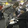 JIM VAIKNORAS/Staff photo Lt.Col Christine Estacion talks with World War 2 veteran Phyllis Bennet at BWI airport in Baltimore.
