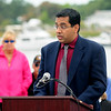 JIM VAIKNORAS/Staff photo Dr Ahmer Ibrahim reads a verse from the Quran during the Relocation Ceremony for the Newburyport Fisherman's Memorial on the boardwalk on the Newburyport Waterfront Monday morning.