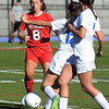 BRYAN EATON/Staff photo. Amesbury's Ashley Pettet moves past Georgetown players.
