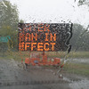 BRYAN EATON/Staff photo. A water ban sign at Newbury's Upper Green is seen through a rain covered windshield yesterday morning. The rain from the remnants of Hurrican Hermine was welcome, but not enough to end the severe drought.
