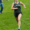 BRYAN EATON/Staff photo. Pentucket's Siobhan O'Keefe is the first runner for her team to cross the finish.