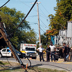 BRYAN EATON/Staff photo. Low Street in Newburyport at Toppan's Lane was closed for awhile on Tuesday early afternoon as a truck caught utility lines causing several poles to snap, some landi ...