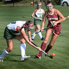 BRYAN EATON/Staff photo. Pentucket's Caroline Cloutier moves the ball as Newburyport's Vicky Justiniano moves in.