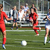BRYAN EATON/Staff photo. Georgetown's Nicole Donnelly heads towards Amesbury's Ashley Pettet.