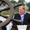 JIM VAIKNORAS/Staff photo Bob Campbell, former manager of Tri-Coastal Fishing Co-op speaks during the Relocation Ceremony for the Newburyport Fisherman's Memorial on the boardwalk on the Newburyport Waterfront Monday morning.