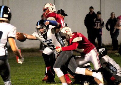 JIM VAIKNORAS/Staff photo  Triton's Liam Spillane stretches out for the goal line as he scores at Amesbury Friday night.