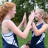BRYAN EATON/Staff photo. Jemma Shea, left, and Anna Cassidento celebrate their team's tying a national record of winning dual meets.