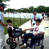JIM VAIKNORAS/Staff photoDexter Murray of Gloucester with his son in law Jon Pratt greets Arthur Bideau of Merrimac Ma with his son Steven at the Lincoln Memorial. They all took part in the Honor Flight New England tour of Washington Sunday.