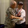 JIM VAIKNORAS/Staff photo General Richard Erickson hugs his dad World War 2 veteran Hubert Erickson after his arrival at Logan Airport Sunday.