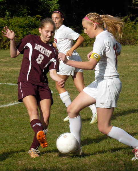 BRYAN EATON/Staff photo. Amesbury's Mollie Lynch moves the ball past Rockport's Rosie McNiff.