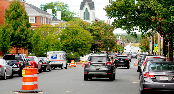 JIM VAIKNORAS/Staff photo Barrels lined up on Green Street in Newburyport in anticipation of paving.