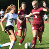 BRYAN EATON/Staff photo. Pentucket's Ellison Seymour runs into Newburyport's Margaret Cote Katie Hadden.