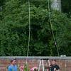 "JIM VAIKNORAS/Staff photo Louis Blatt and Joe Fix install ""Un Volo Sopra Il Giadino"" at Maudsay in Newburyport."